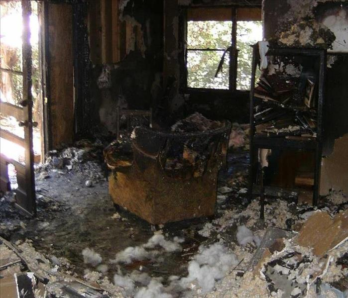 West Palm Beach Living Room Experiences Severe Fire Damage Before