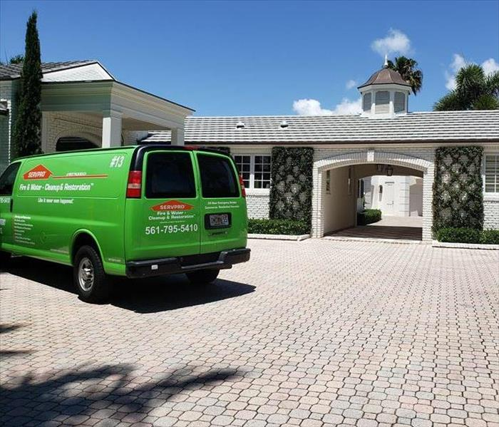 SERVPRO green van outside of West Palm Beach home